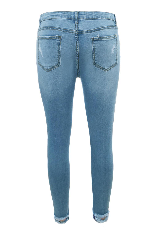 185b69fe4dd Светло-голубые джинсы-скинни с дырами и разрезами - купить ...